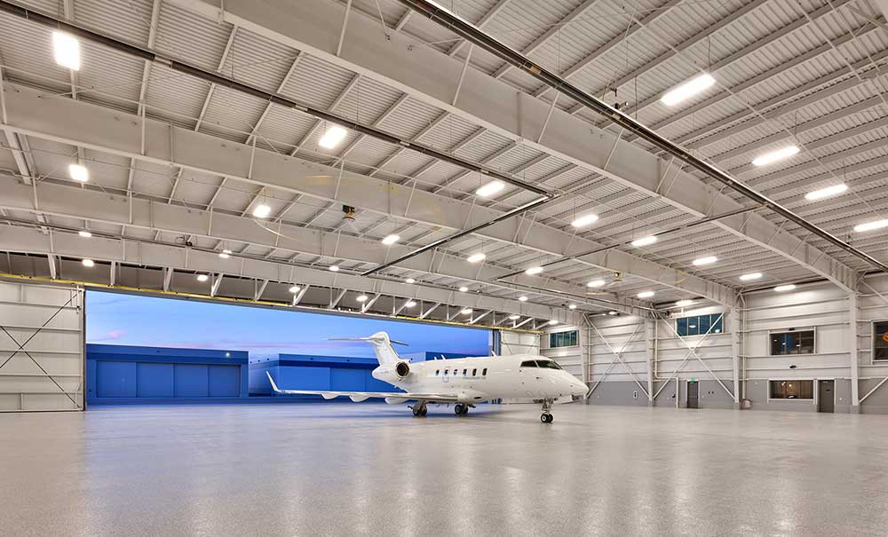 Vivint aircraft hangar curtis miner architecture for Cost of building a house in utah